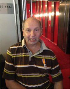 Foto Andre Pijnaker Secretaris van de BGH krijgt lintje.